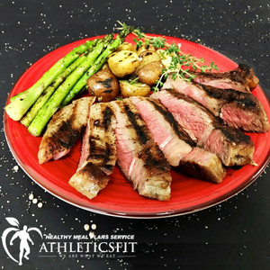 10 oz Grass fed Grilled Rib eye steak with roasted potatoes and grilled asparagus. Good for 2 people.