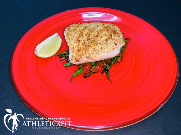 Wild almond-crusted cod on top of bed organic green beans and sundried tomatoes. Ingredients: Wild cod, organic almond, dijon mustard, organic green beans, organic tomatoes.