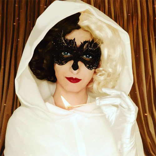 White Cruella hooded costume from the ball