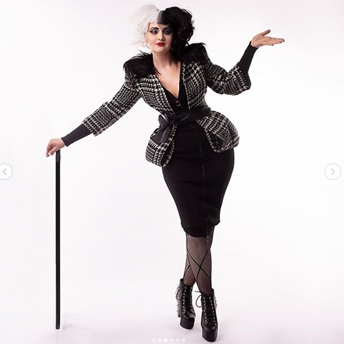 Cruella costume, plaid jacket with cane and pencil skirt