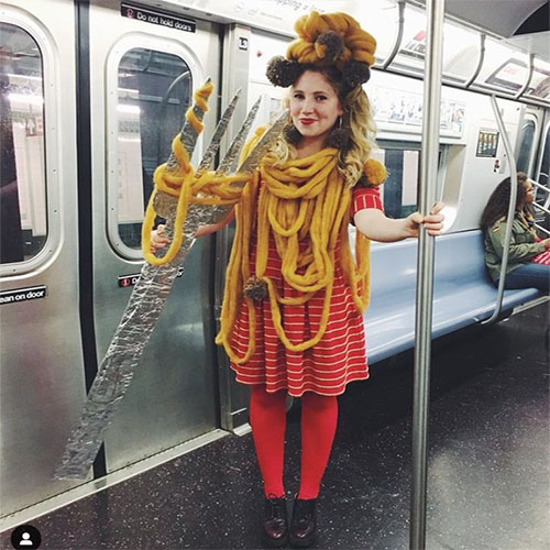Woman In NYC Subway Dressed as Spaghetti and Meatballs with Fork