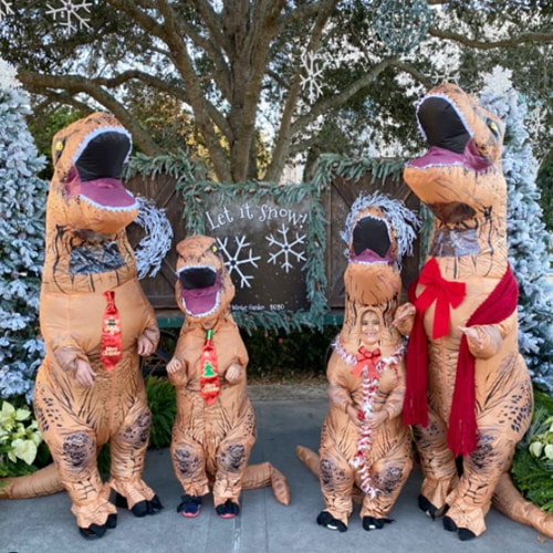 Family in T-Rex Dinosaur Inflatable Costume