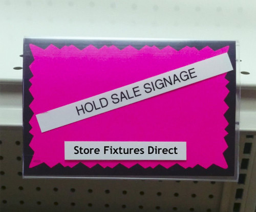 Insert these sign holders into your gondola shelving ticket channel for a simple way to hold up signs.