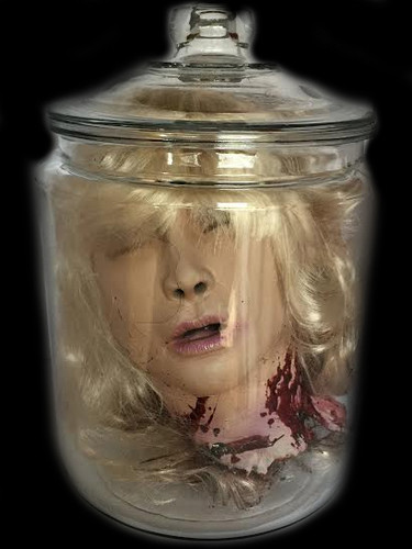 Severed Blond Female Head In A Jar