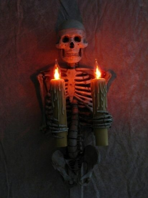 Skeleton Torso Wall Sconce Holding Two Candles