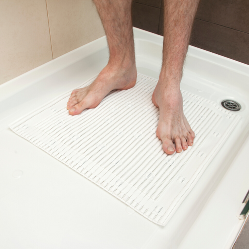 THE STAYPUT SHOWER MAT WITH FEET