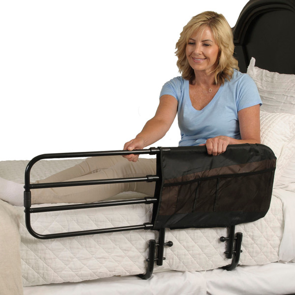 ADJUSTABLE BED RAIL USED BY LADY IN BED
