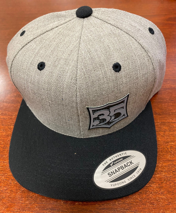 Snap back hats with 35 crest patch