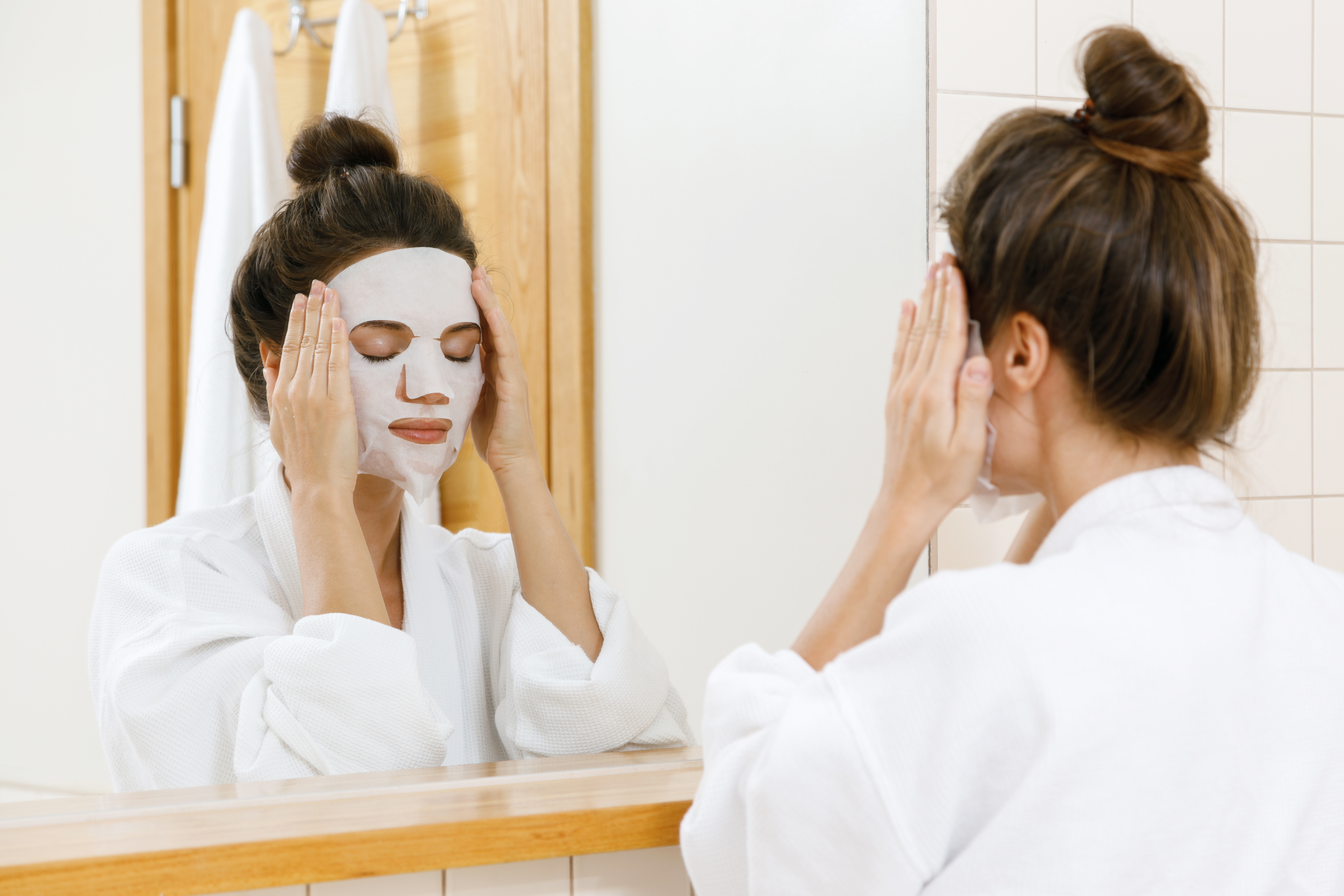 Korean skincare Woman is applying sheet mask on her face