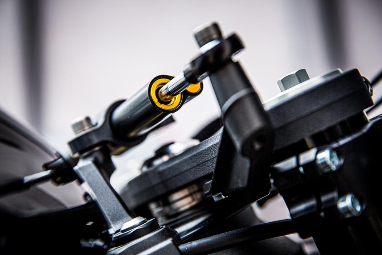ZX6R Ohlins steering damper upper triple bracket