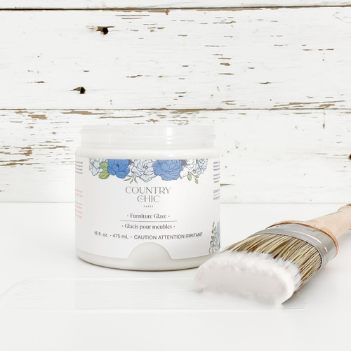 Jar of clear furniture glaze with brush stroke showing color
