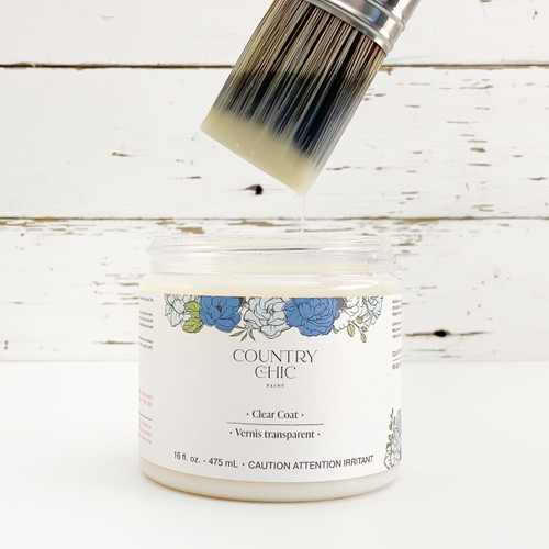 16 oz jar of Country Chic Paint Clear Coat with lid off and paint brush dipped in