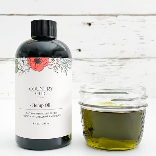 Bottle of Country Chic Paint hemp oil with mason jar full of hemp oil