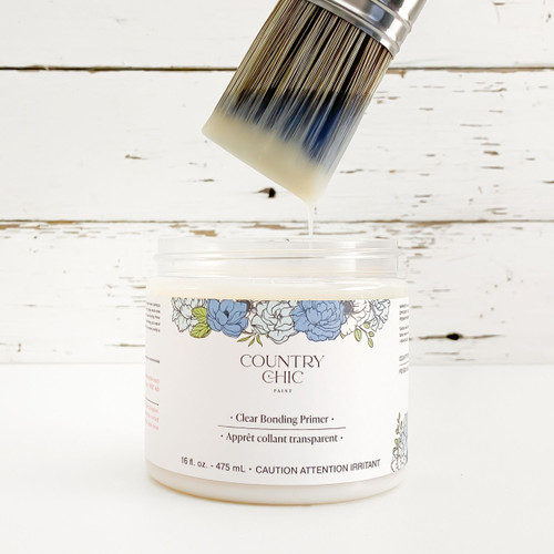 16 oz jar of Country Chic Paint Clear Bonding Primer with paint brushed dipped in