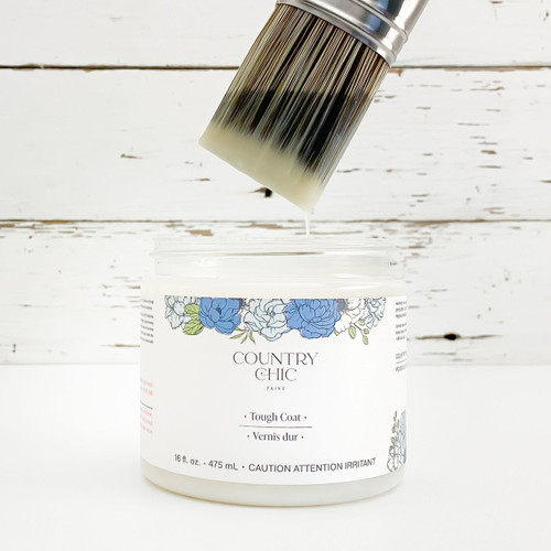 16 oz jar of Country Chic Paint Tough Coat with paint brush dipped into it