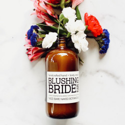 """When we think """"Bride"""" flowers come to mind, so Blushing bride is no exception! Organic Jasmine Extract, Ylang Ylang and Blue Cypress work harmoniously to create a lovely floral hand and body cream. This limited edition body cream deeply hydrates while offering a non-greasy hydration."""