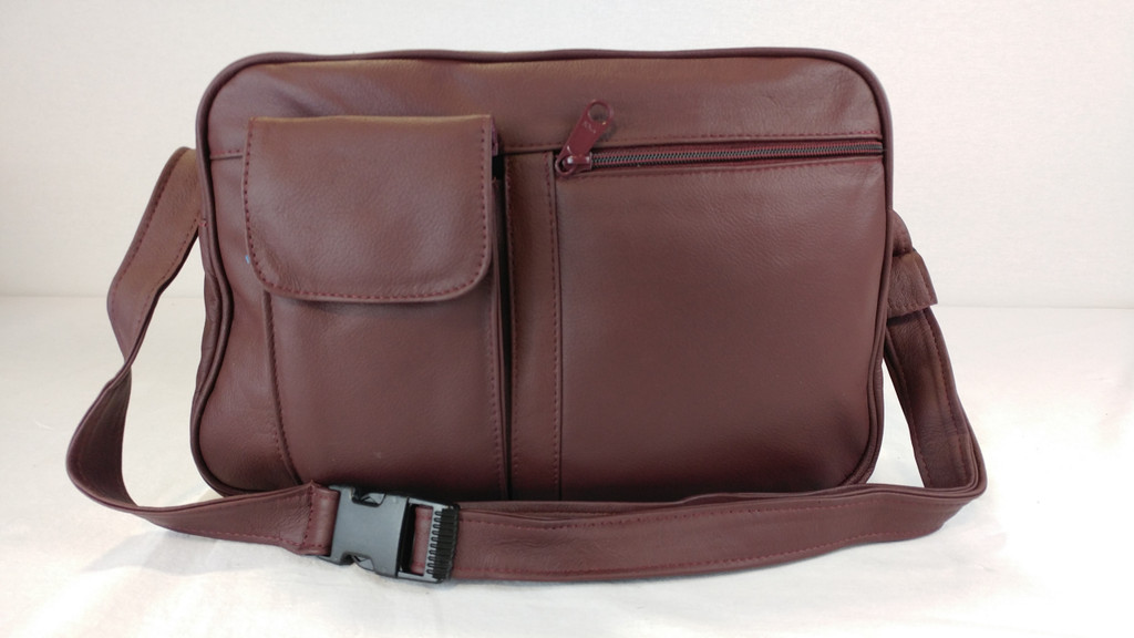 Has clip for wearing as a waist pack.  Pocket with flap is large enough for most cell phones or sun glasses.