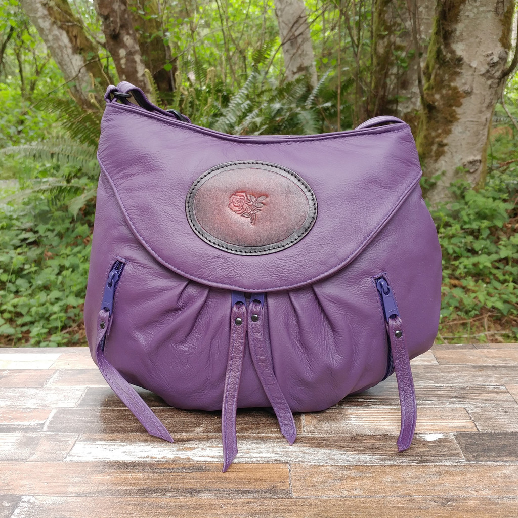 Beautiful soft tanned purple leather with tooled rose medallion.   This is the bag you  will  get when placing your order from this page.