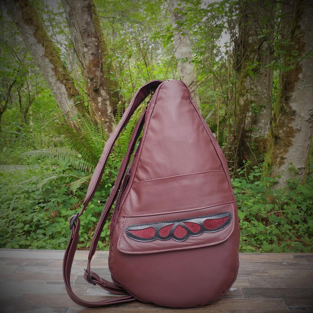 Medium Burgundy TravelMate Backpack With Burgundy Overlay.