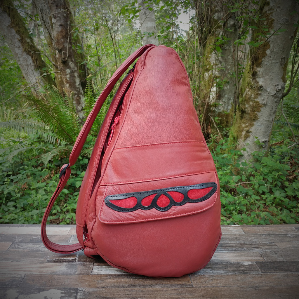 Medium Red TravelMate Backpack With Red Overlay.