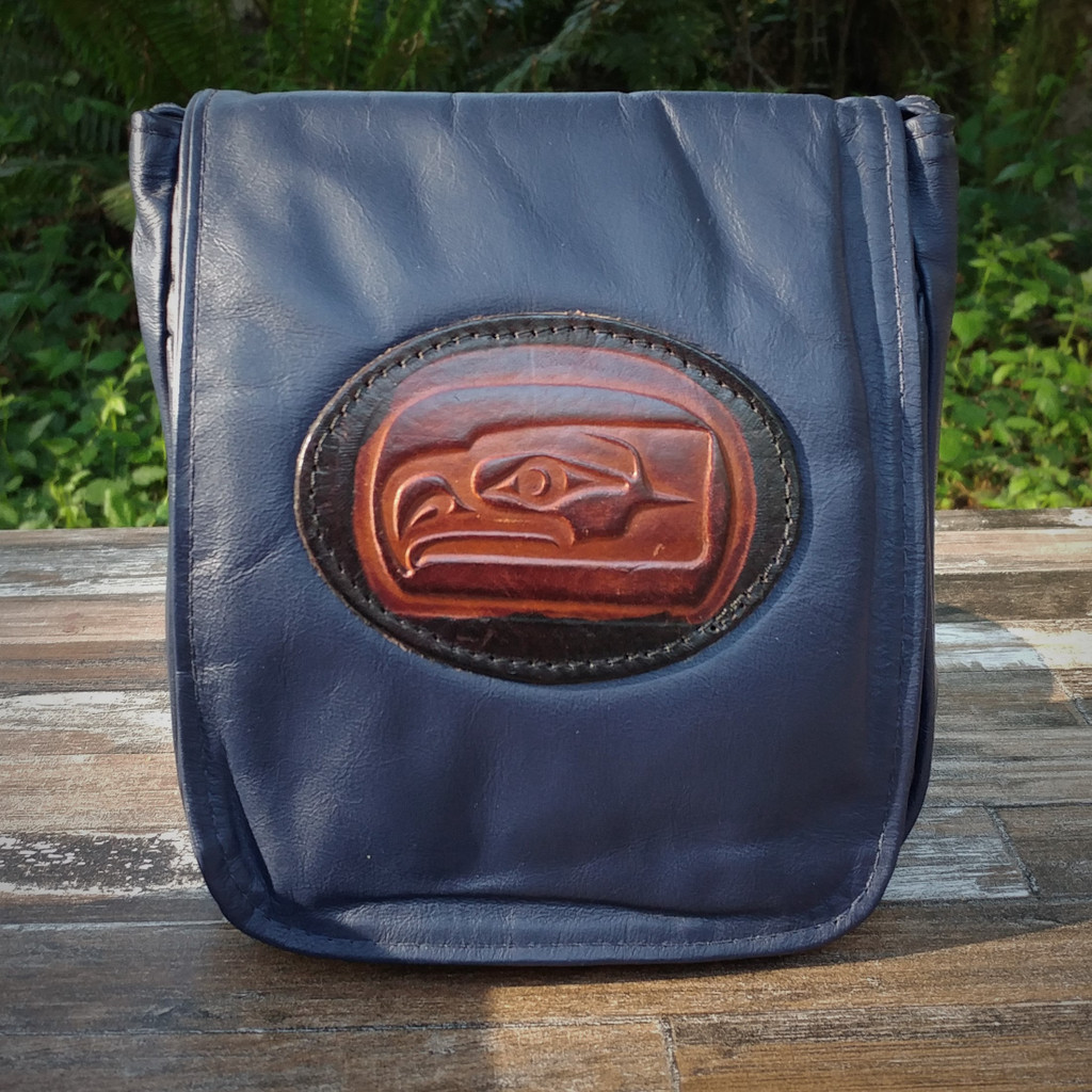 "Navy ""Little Black Purse"" with Tooled SeaHawk  Combines the elegant look and quality of soft leather with a Tooled chromed latigo front flap."