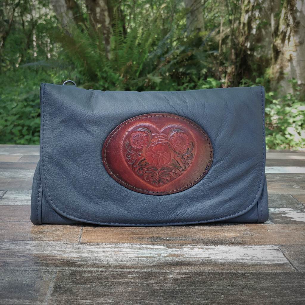 Navy Strapped Wallet with Tooled Celtic Heart Medallion.  Combines the elegant look and quality of soft leather with a Tooled chromed latigo front flap.