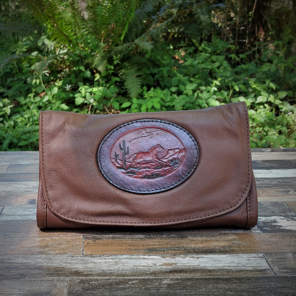 Dark Brown Strapped Wallet with Tooled Running Horse Medallion.  Combines the elegant look and quality of soft leather with a Tooled Leather Medallion on the front flap.