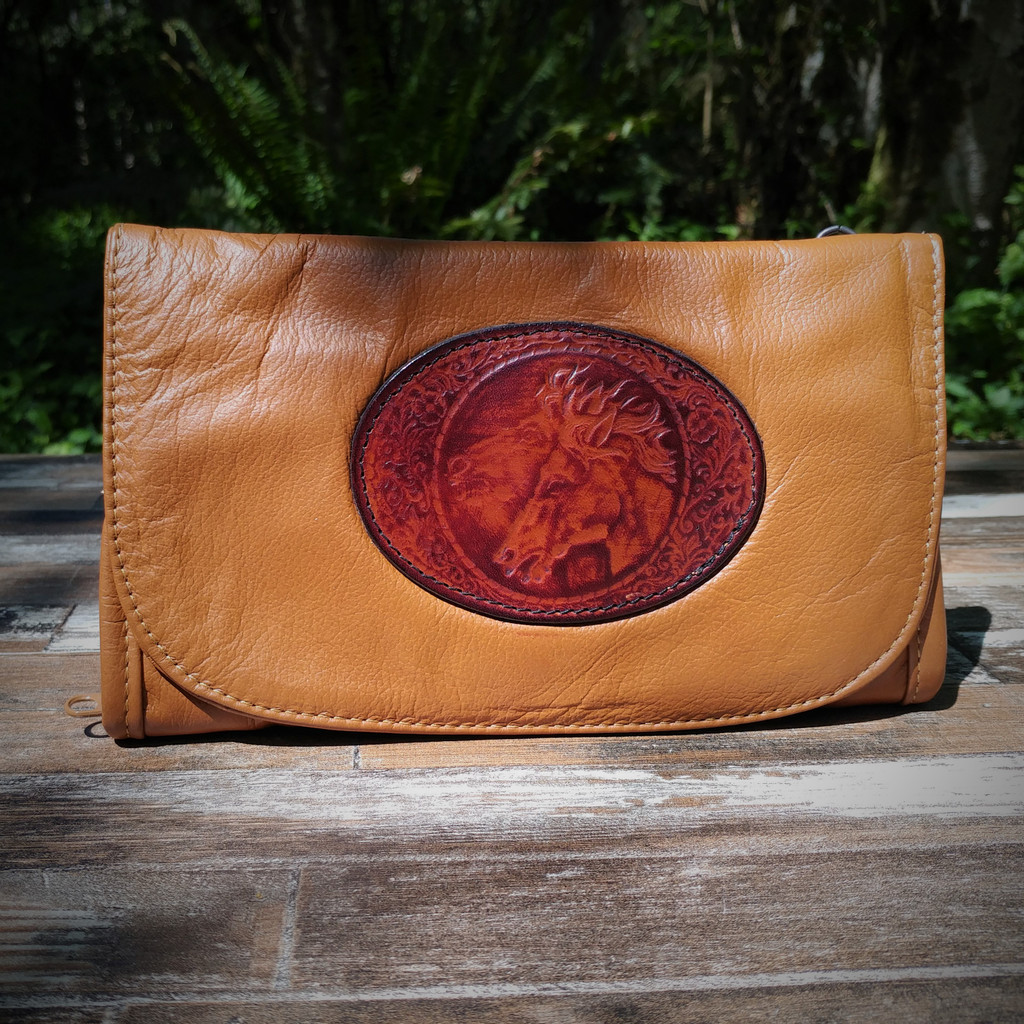 Cognac Strapped Wallet with Tooled Double Horse Head Medallion.  Combines the elegant look and quality of soft leather with a Tooled Leather Medallion on the front flap.
