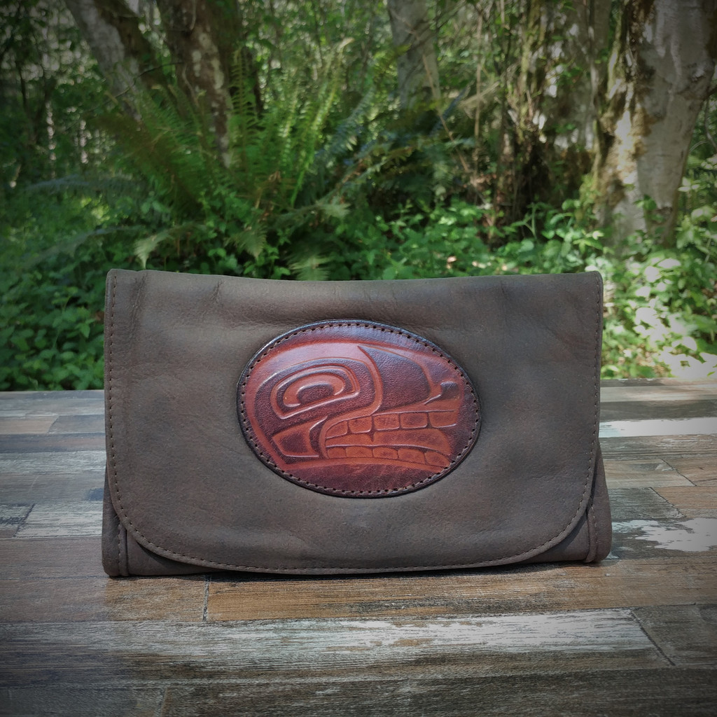 Distressed Brown Strapped Wallet with Tooled N.W. Indian Wolf Medallion.  Combines the elegant look and quality of soft leather with a Tooled chromed latigo front flap.
