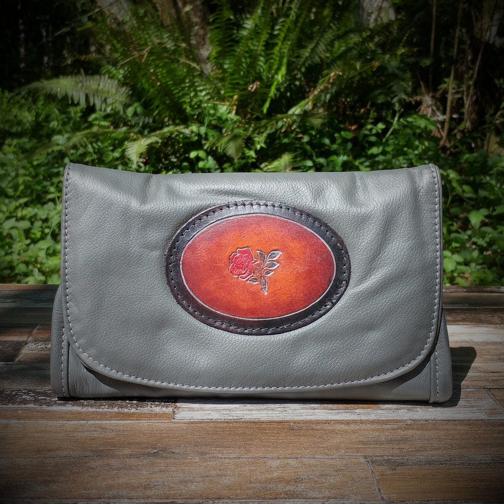Grey Strapped Wallet with Tooled Rose Medallion.  Combines the elegant look and quality of soft leather with a Tooled chromed latigo front flap.
