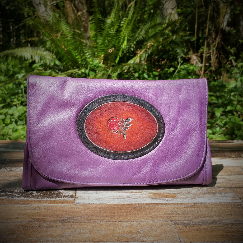 Purple Strapped Wallet with Tooled Rose Medallion.  Combines the elegant look and quality of soft leather with a Tooled chromed latigo front flap.