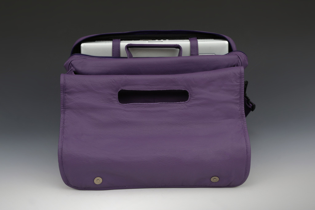 One section has zippered closure with wide opening also with computer straps for stability. Second section is open with zippered wall pocket for easy access.
