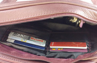 Has three separate zippered and individually lined sections accessed from the top.