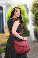 """Large-Amber is 5'10"""" tall, this size has a long enough strap to wear on one shoulder or across body.  Strap can be shortened all the way up to under the arm/hand carry."""