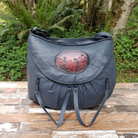 Navy Small Route #66 Hobo with Tooled Dogwood Medallion.