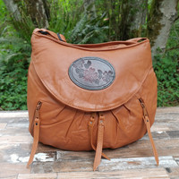 Cognac Medium Route #66 Hobo with Tooled Dogwood Medallion.  A little taller and wider than the small.  Roomy without looking too big.