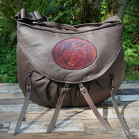 Distressed Brown Small Route #66 Hobo with Tooled Horse Heads Medallion.