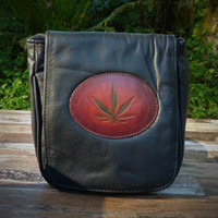 """Black """"Little Black Purse"""" with Tooled Pot Leaf.  Combines the elegant look and quality of soft leather with a Tooled chromed latigo front flap."""
