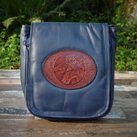 "Navy ""Little Black Purse"" with Tooled Double Horse Heads.  Combines the elegant look and quality of soft leather with a Tooled chromed latigo front flap."