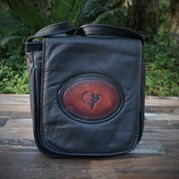 "Black""Little Black Purse"" with Tooled Rose.  Combines the elegant look and quality of soft leather with a Tooled chromed latigo front flap."