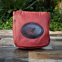 "Red ""Little Black Purse"" with Tooled Rose.  Combines the elegant look and quality of soft leather with a Tooled chromed latigo front flap."