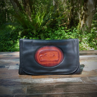Black Strapped Wallet with Tooled SeaHawk Medallion  Combines the elegant look and quality of soft leather with a Tooled chromed latigo front flap.