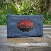 Navy Strapped Wallet with Tooled Sunset Medallion.  Combines the elegant look and quality of soft leather with a Tooled Leather Medallion on the front flap.