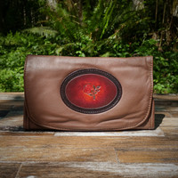 Brown Strapped Wallet with Tooled Rose Medallion.  Combines the elegant look and quality of soft leather with a Tooled Leather Medallion on the front flap.