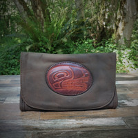 Distressed Brown Strapped Wallet with Tooled N.W. Indian Wolf Medallion.  Combines the elegant look and quality of soft leather with a Tooled Leather Medallion on the front flap.