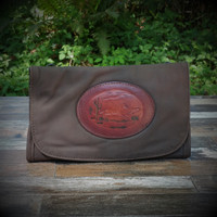 Distressed Brown Strapped Wallet with Tooled Running Horse Medallion.  Combines the elegant look and quality of soft leather with a Tooled Leather Medallion on the front flap.
