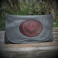 Grey Strapped Wallet with Tooled Celtic Heart Medallion.  Combines the elegant look and quality of soft leather with a Tooled Leather Medallion on the front flap.