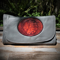 Grey Strapped Wallet with Tooled Double Horse Heads Medallion.  Combines the elegant look and quality of soft leather with a Tooled chromed latigo front flap.