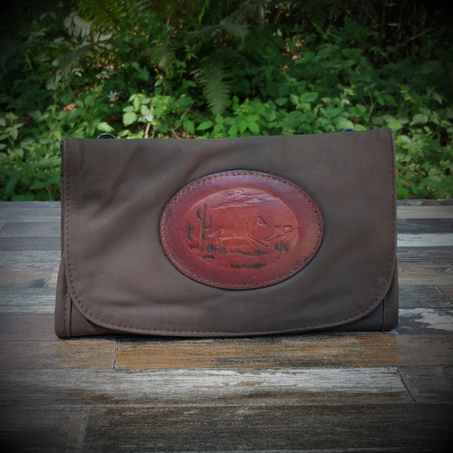 Distressed Brown Strapped Wallet with Tooled Running Horse Medallion.  Combines the elegant look and quality of soft leather with a Tooled chromed latigo front flap.