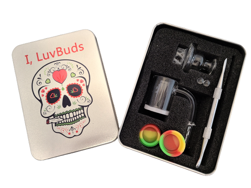 LuvBuds  25MM banger kit comes with 14MM male banger, wax container, vortex carb cap, pearls, and dab tool in a silver Louie Luv Skull tin!
